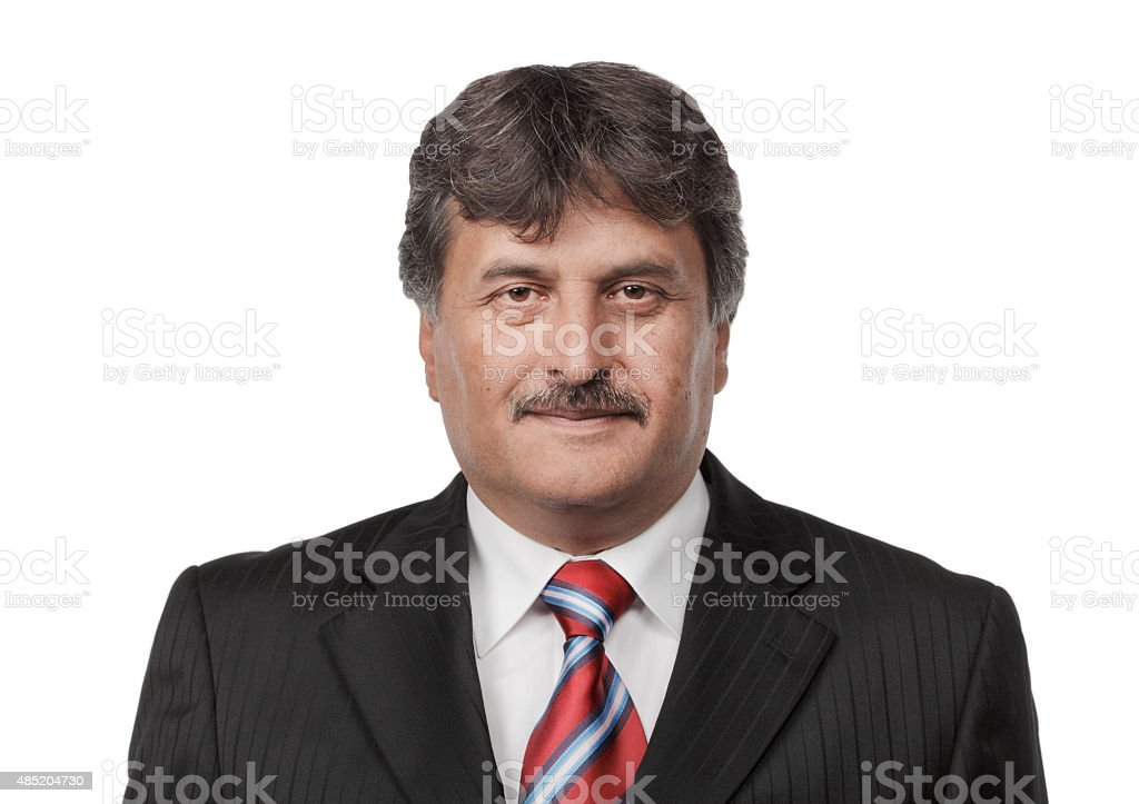 Mature business man standing isolated on white background stock photo