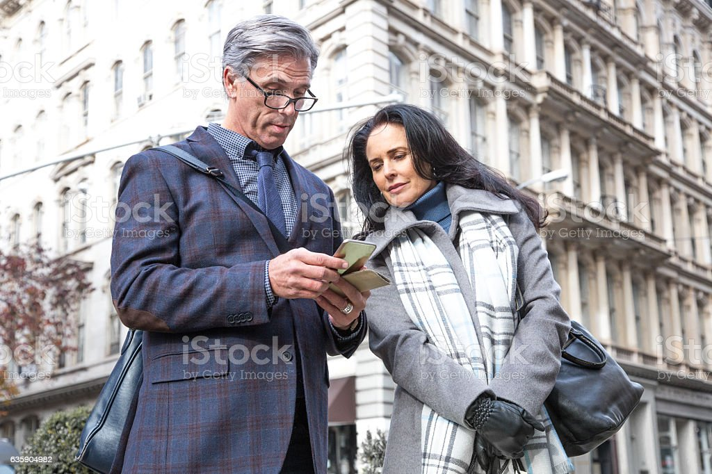 Mature Business Man using Cell Phone in City stock photo