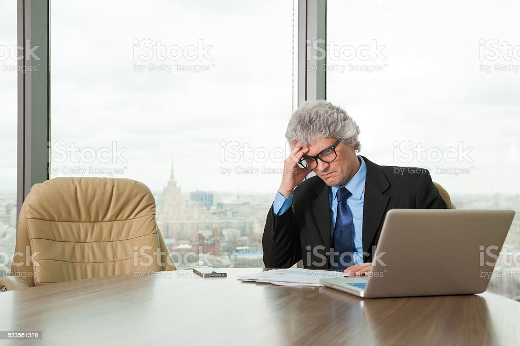Mature business man works with docs stock photo