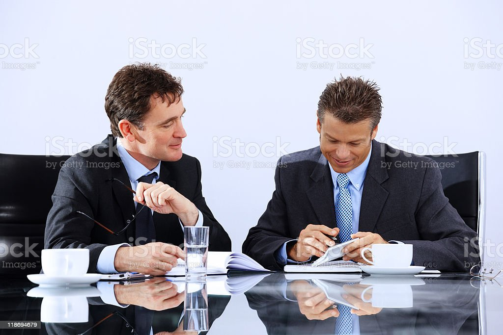 Mature Business mentor working with client on ideas royalty-free stock photo