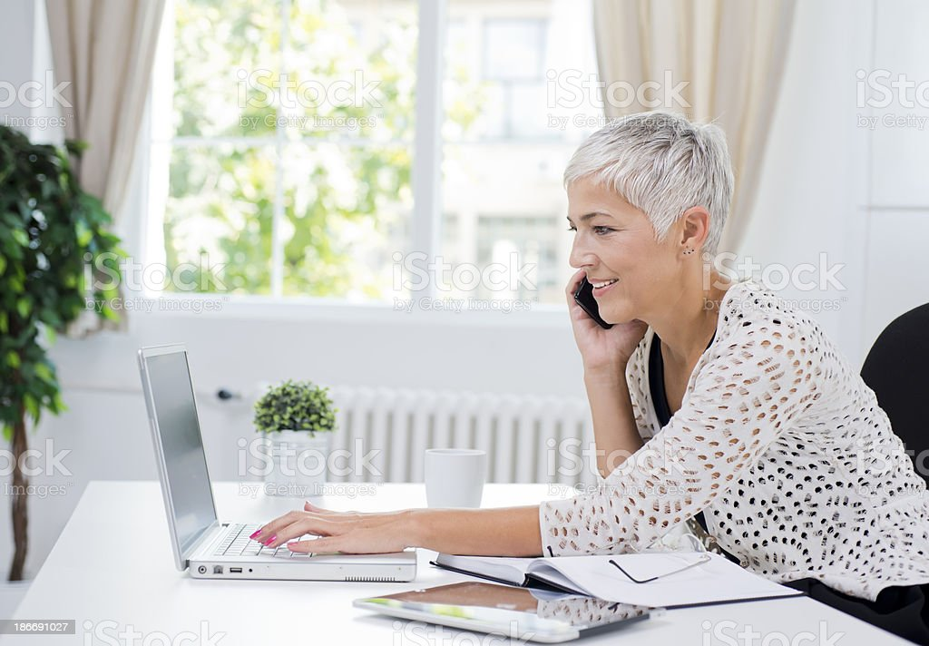 Mature business woman at the office royalty-free stock photo