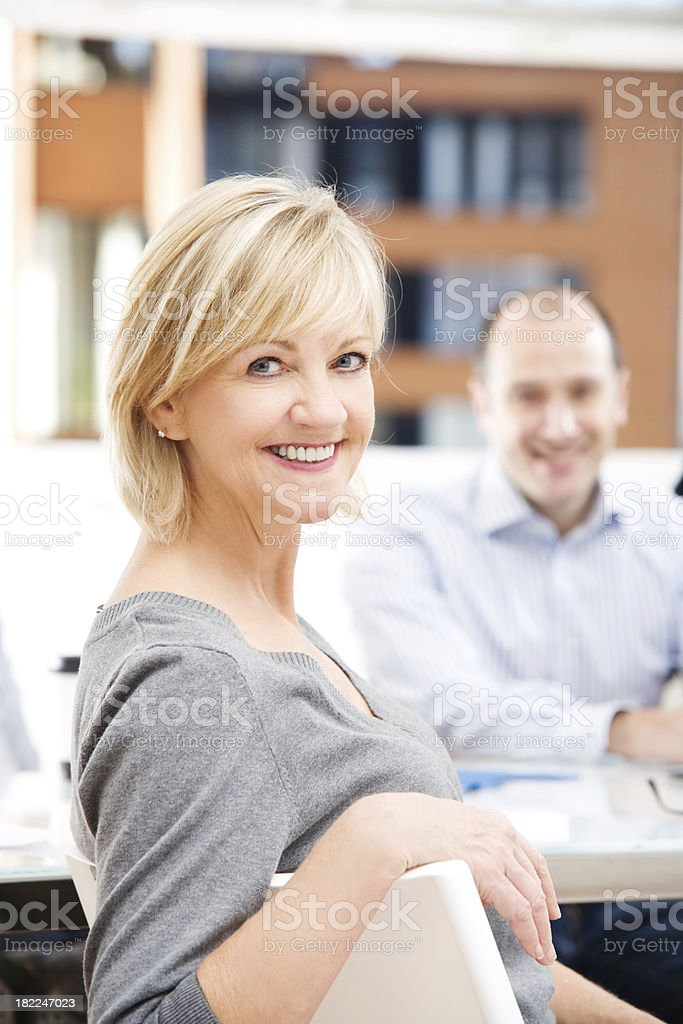 Mature business woman looking at the camera royalty-free stock photo