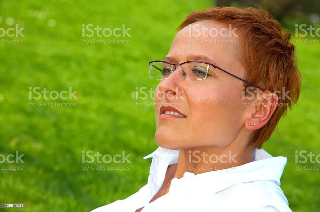 Mature business woman lost in deep thought royalty-free stock photo