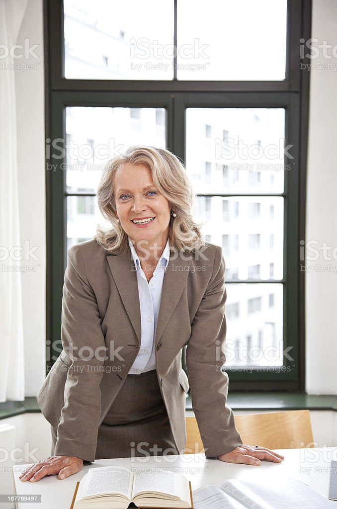 Mature business woman smiling royalty-free stock photo
