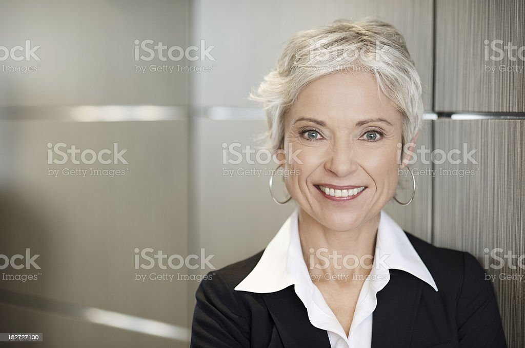 Mature business woman smiling stock photo