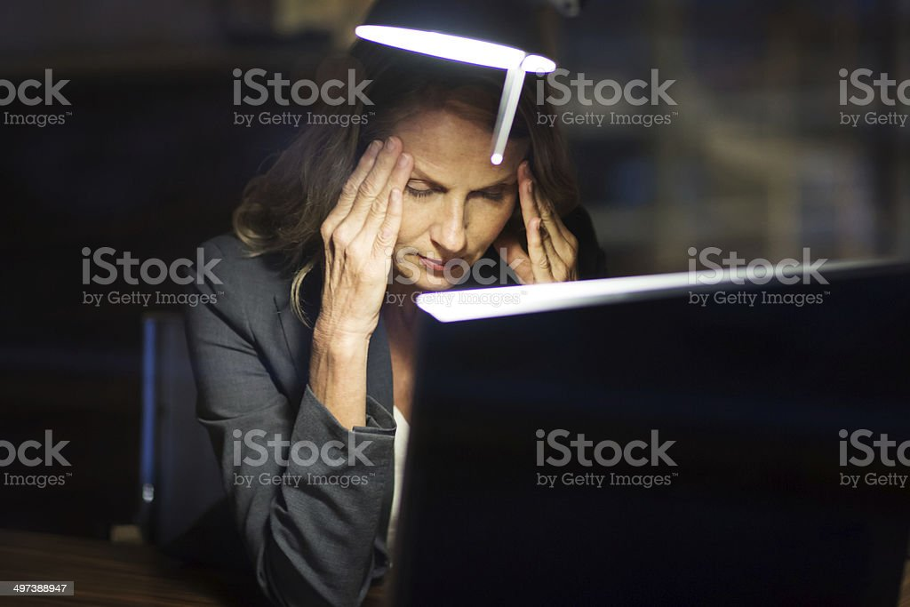 Mature Business Woman Working Late stock photo