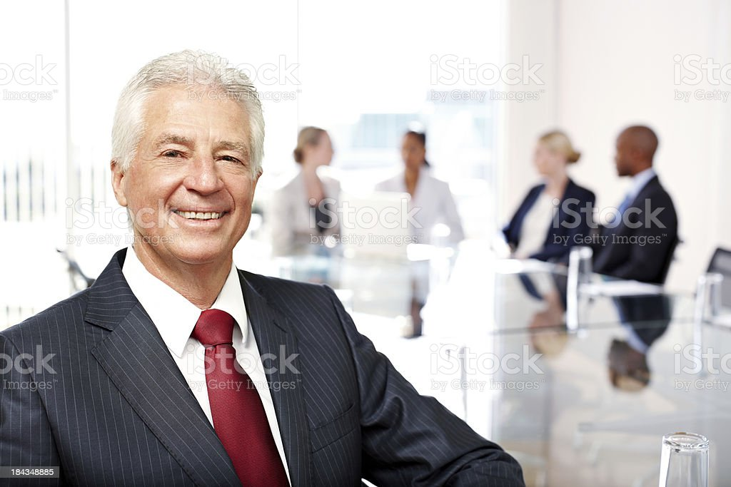 Mature Businessman at a Conference Table royalty-free stock photo