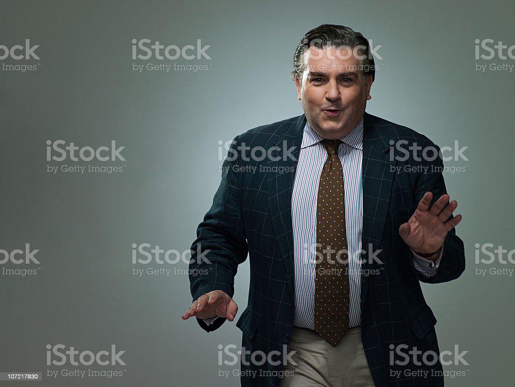Mature businessman dancing, portrait stock photo