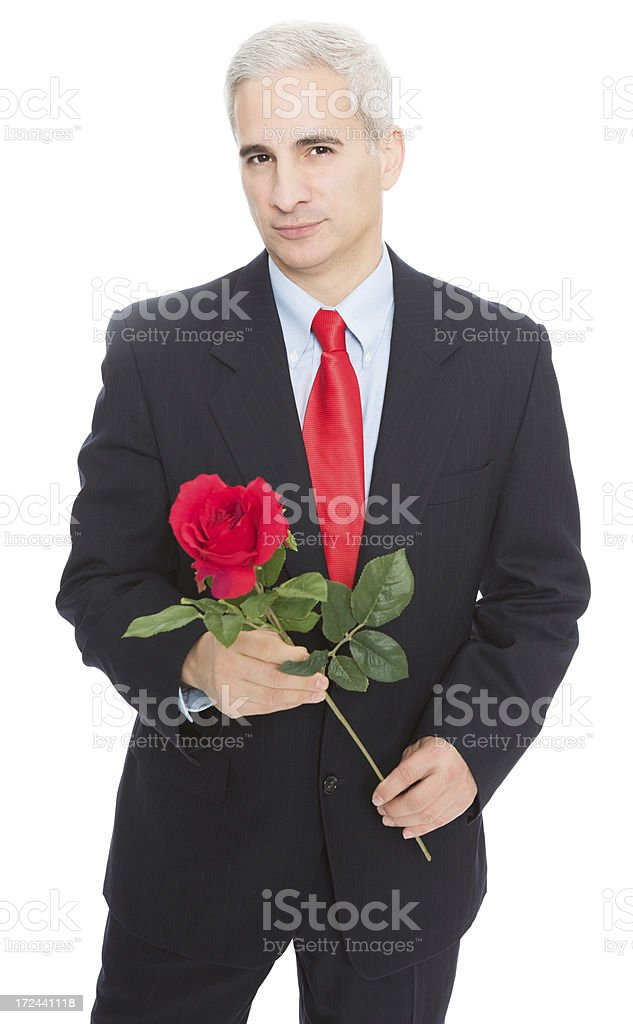 Mature Businessman Holding Red Rose royalty-free stock photo