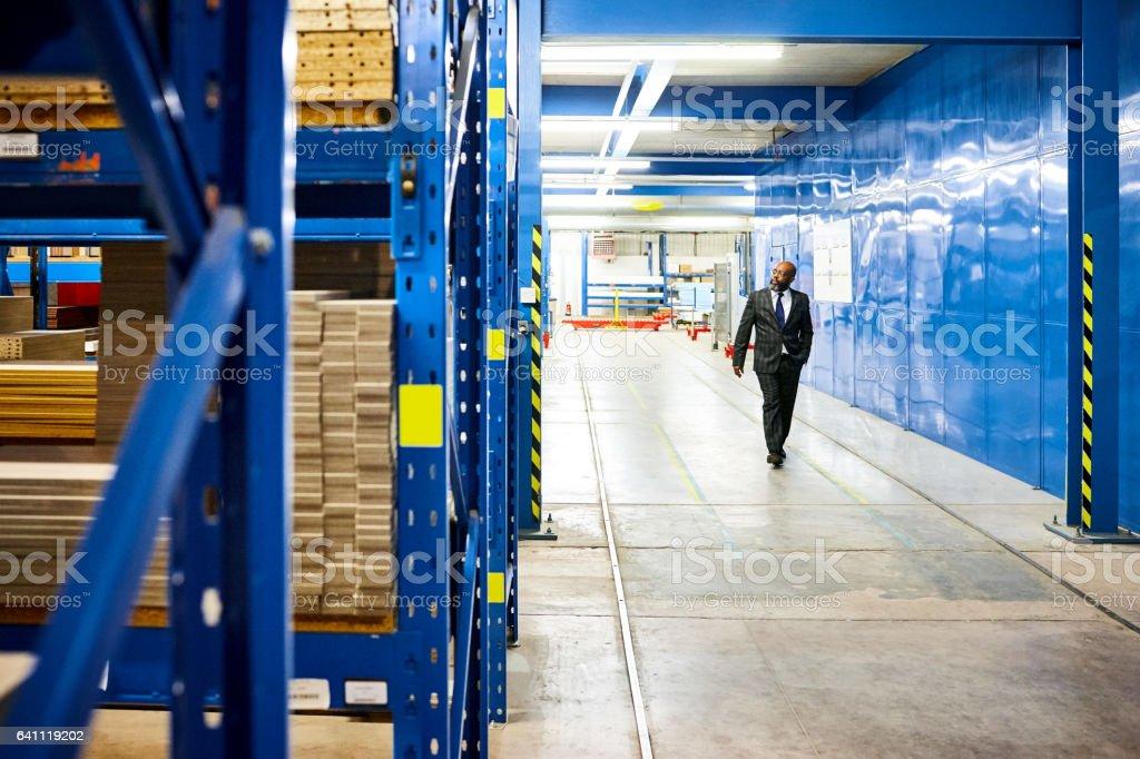 Mature businessman in distribution warehouse stock photo