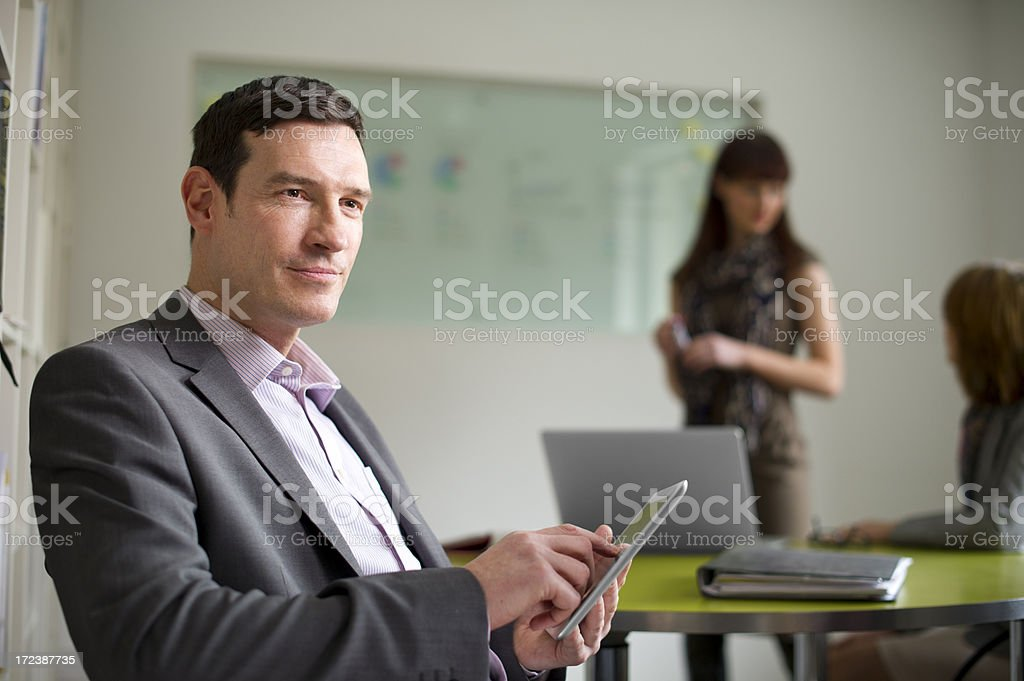 mature businessman in his office environment royalty-free stock photo