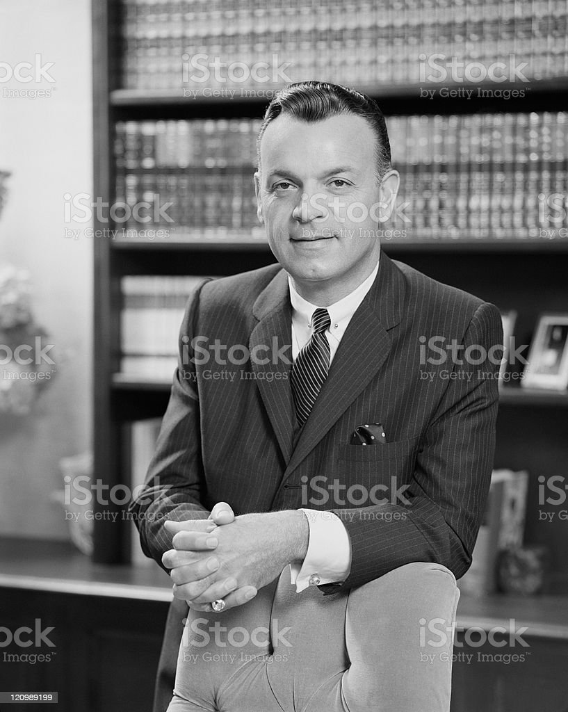 Mature businessman in office, smiling, portrait royalty-free stock photo