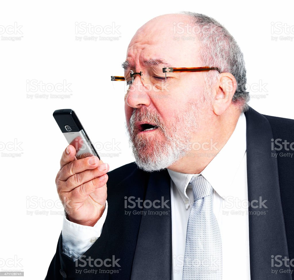 Mature businessman looking at cellphone royalty-free stock photo