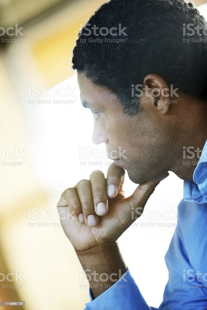 Mature businessman looking away in thought royalty-free stock photo