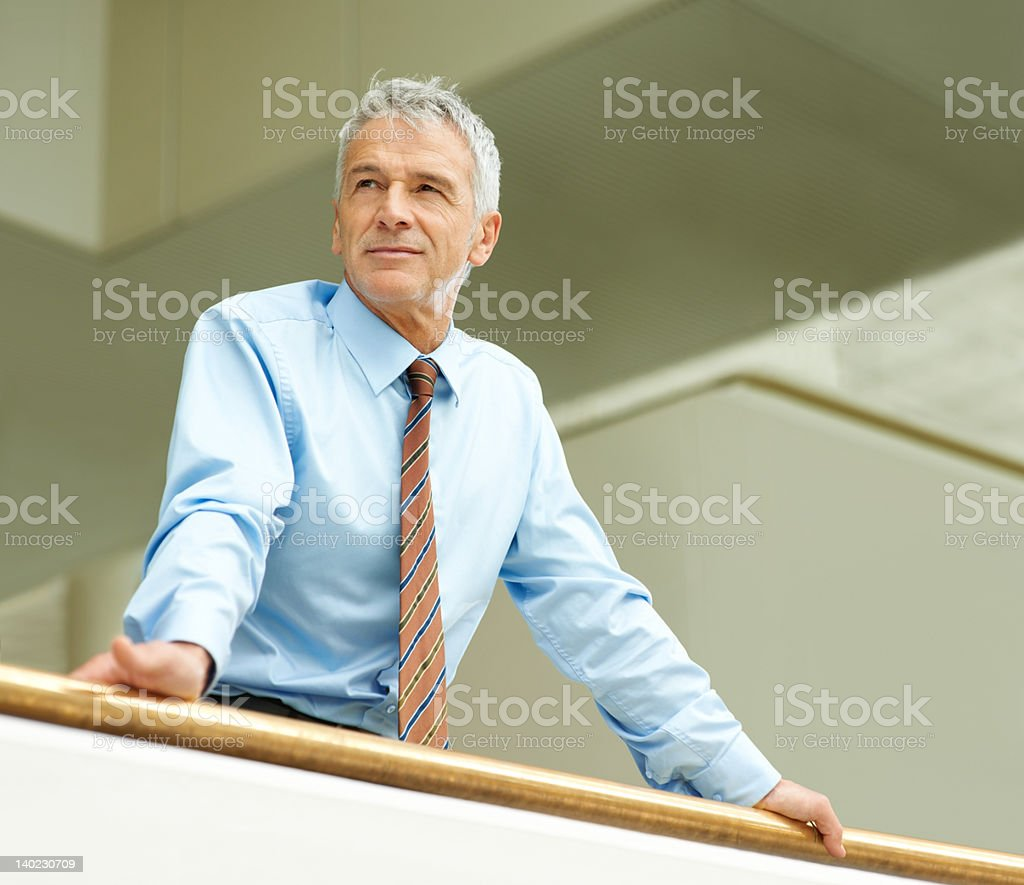 Mature businessman lost in thought stock photo