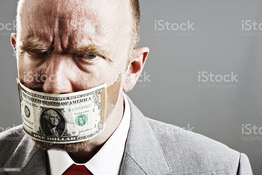 Mature businessman maddened by dollar bill gag stock photo