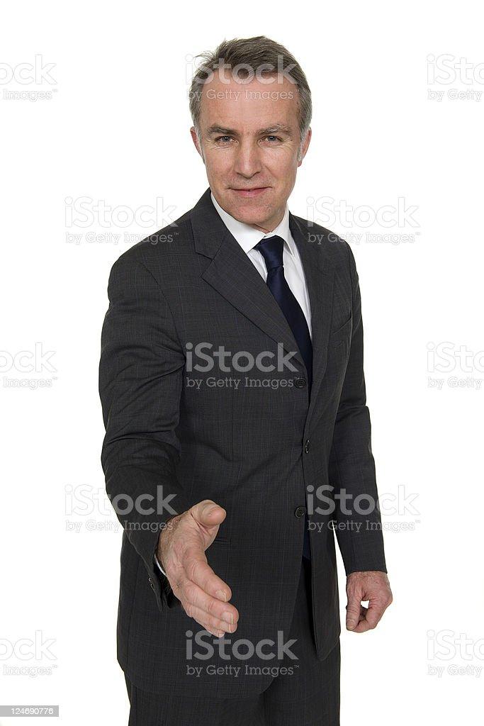 Mature businessman offering handshake stock photo