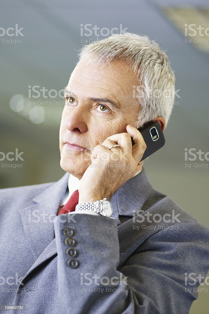 mature businessman on the phone in office royalty-free stock photo