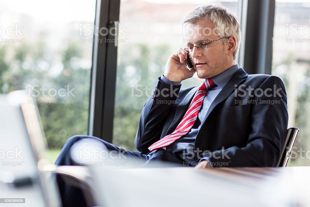 Mature Businessman on the phone stock photo