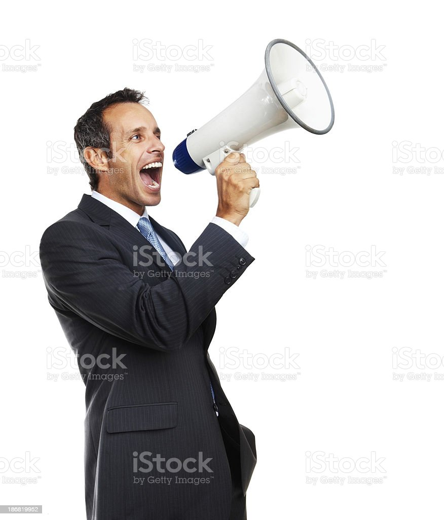 Mature businessman screaming into megaphone royalty-free stock photo
