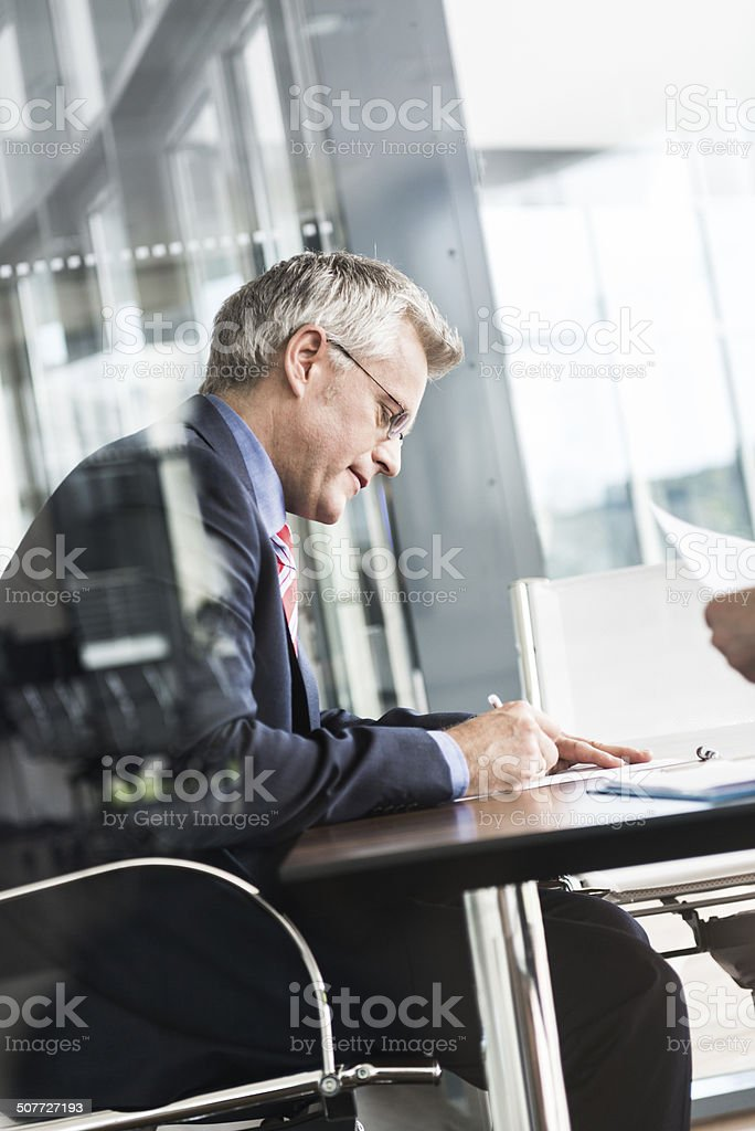 Mature Businessman Signing Contract stock photo