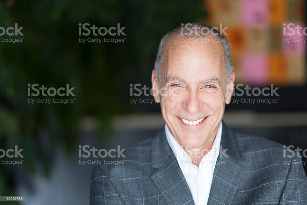 Mature Businessman Smiling At The Camera stock photo