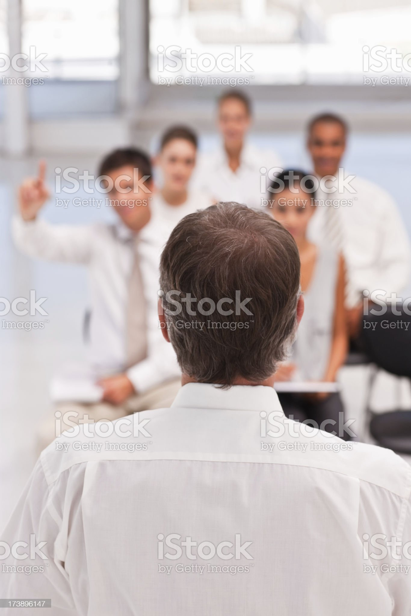 Mature businessman taking a meeting in office royalty-free stock photo