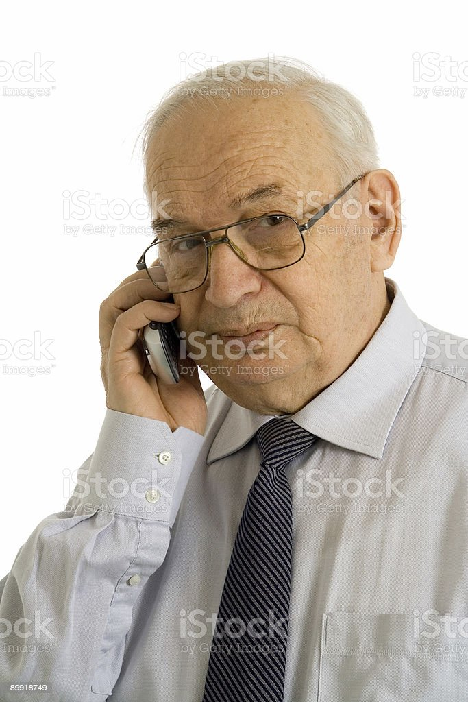 Mature businessman talking on his cell phone royalty-free stock photo