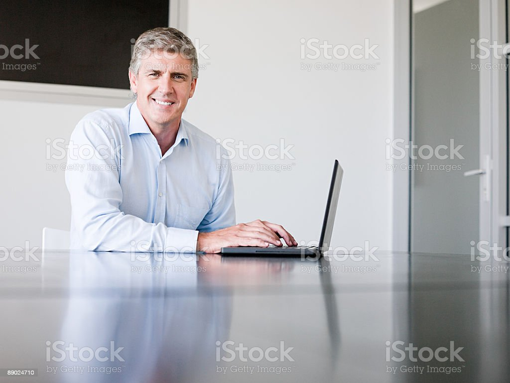 Mature businessman using a laptop computer royalty-free stock photo