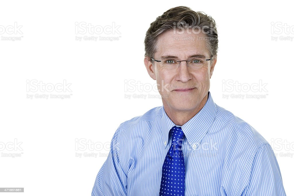 Mature businessman with a slight smile royalty-free stock photo
