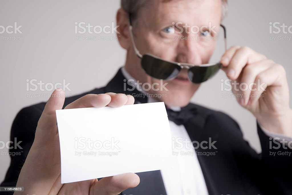 Mature businessman with card stock photo