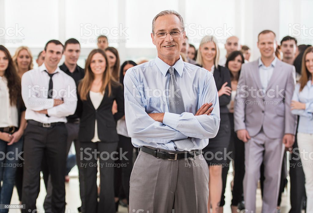 Mature businessman with crossed arms looking at the camera. stock photo
