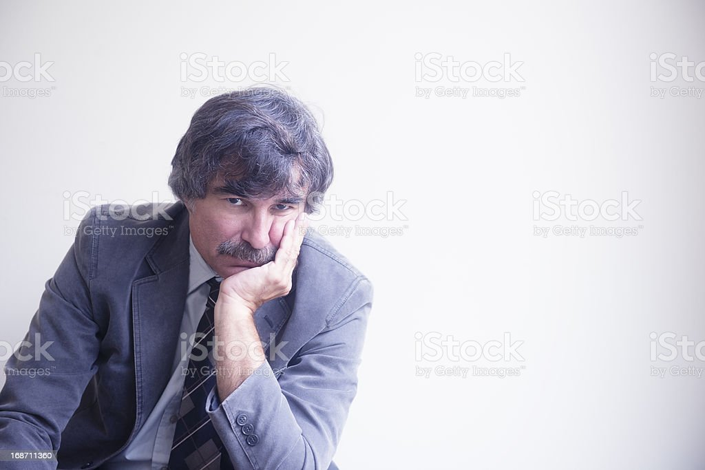 Mature Businessman with Head In Hand royalty-free stock photo