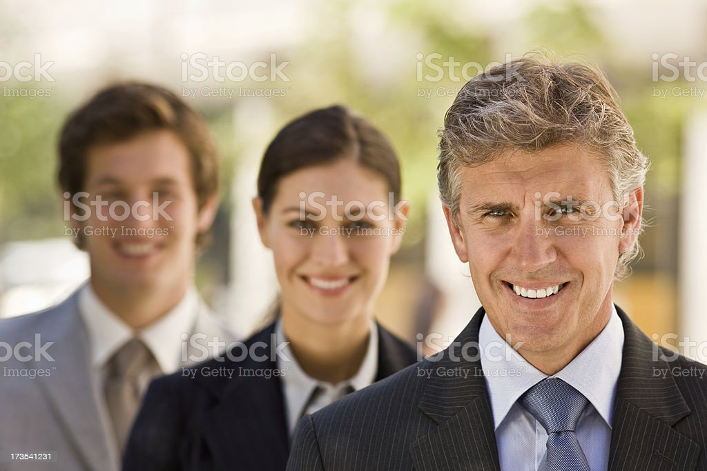 Mature businessman with his colleagues royalty-free stock photo