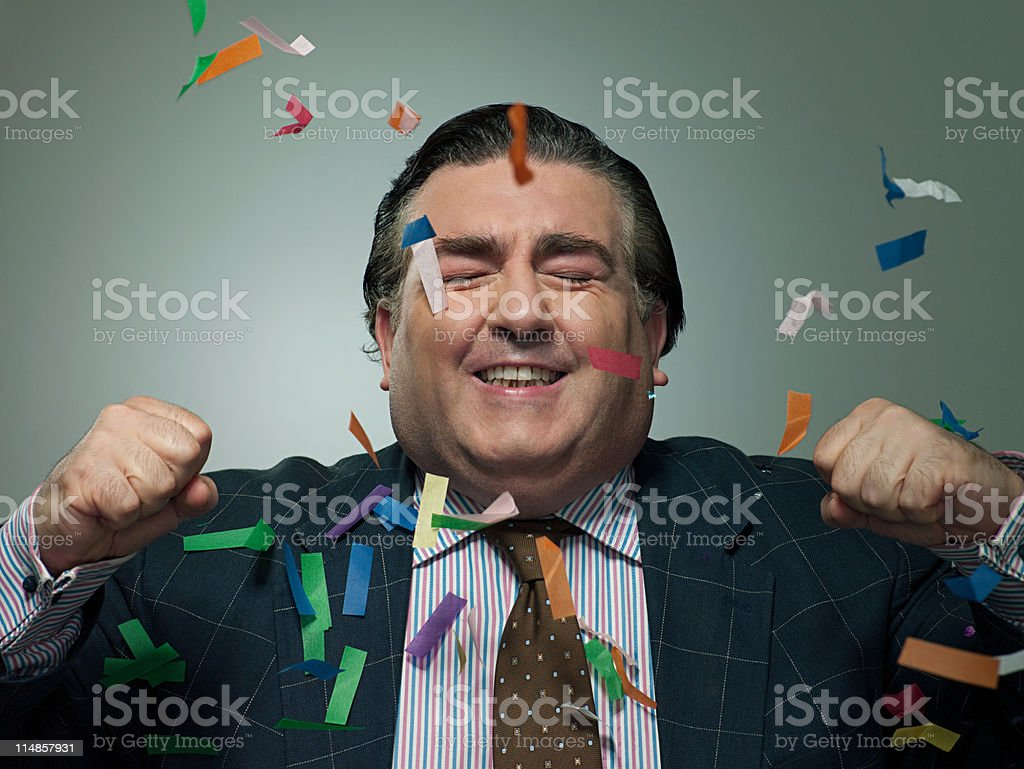 Mature businessman with ticker tape, portrait stock photo