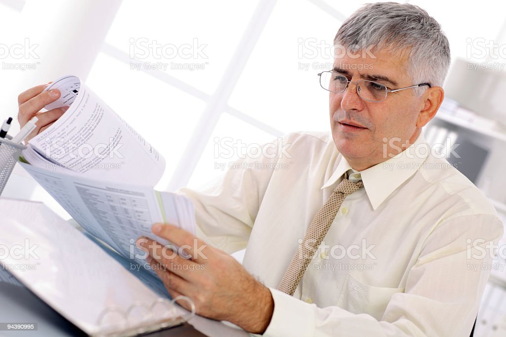 Mature businessman working at the office. royalty-free stock photo