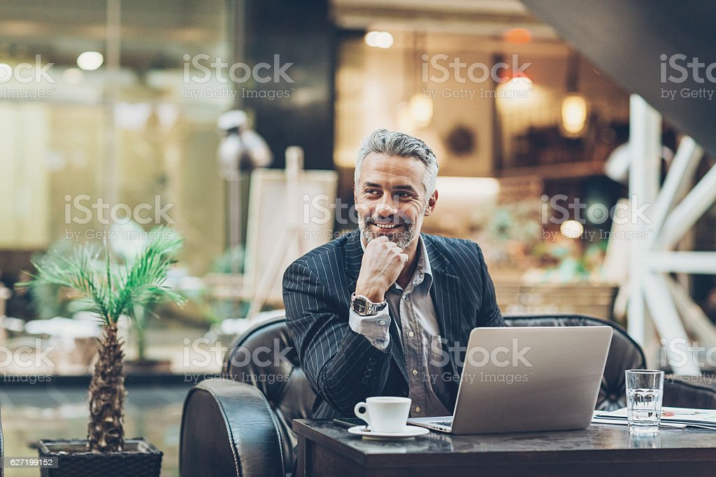 Mature businessman working in comfort stock photo