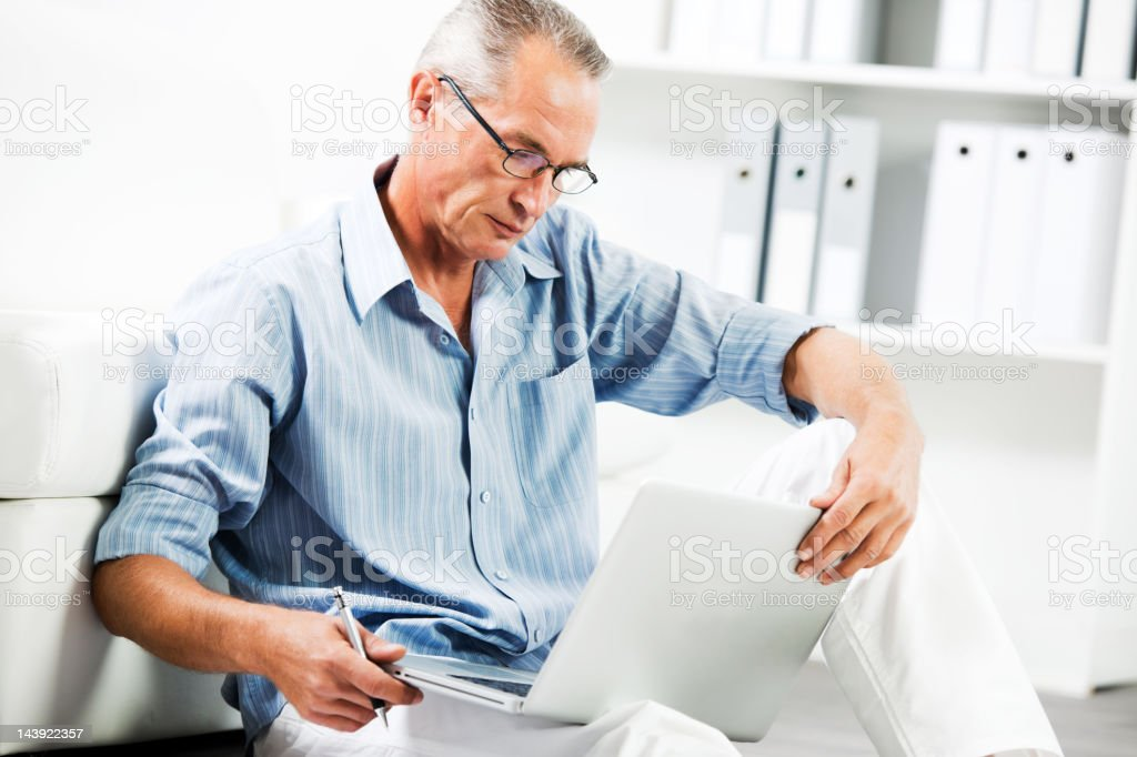 Mature businessman working on his laptop royalty-free stock photo