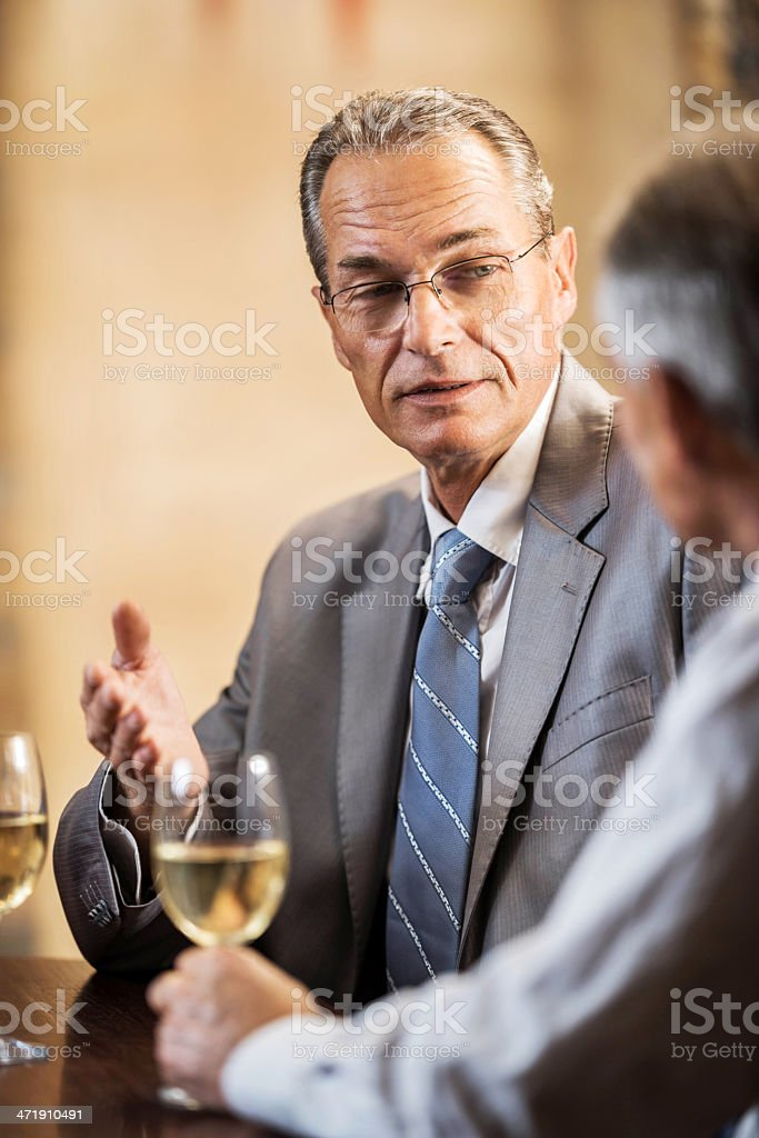 Mature businessmen communicating. royalty-free stock photo