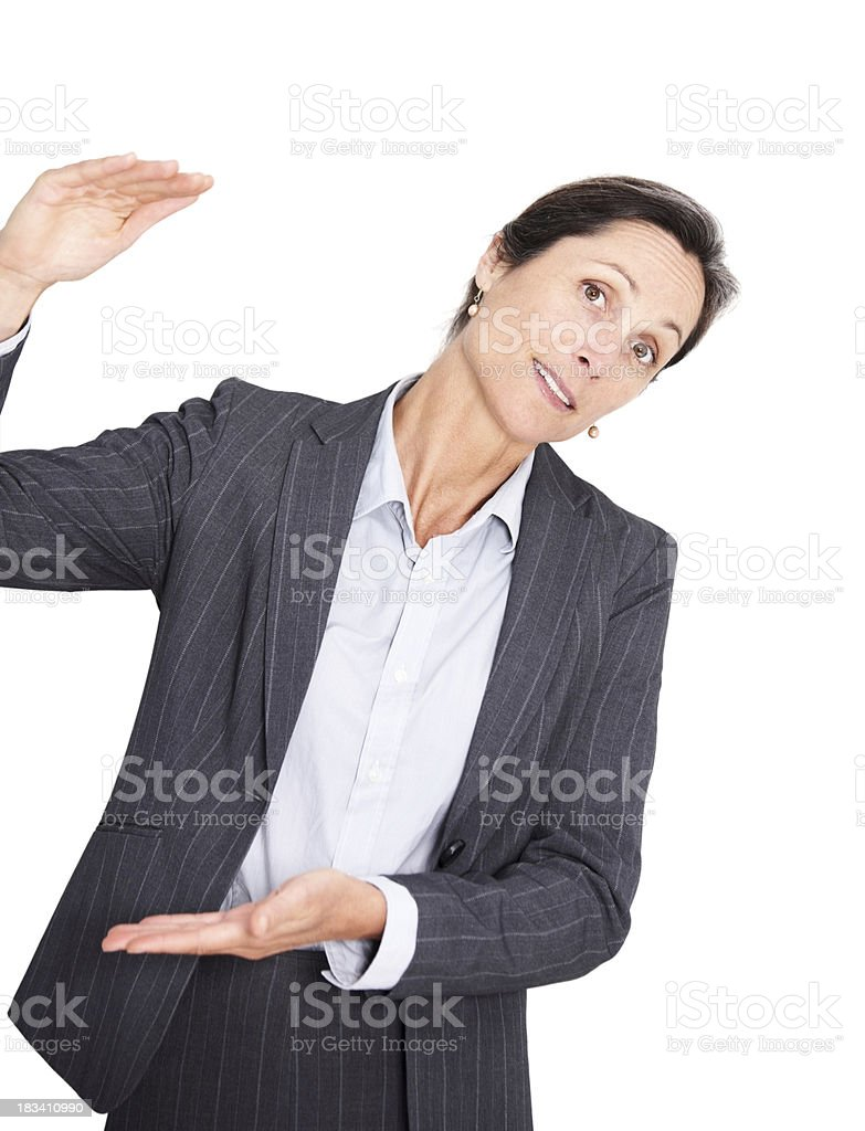 Mature businesswoman doing gestures with hand royalty-free stock photo