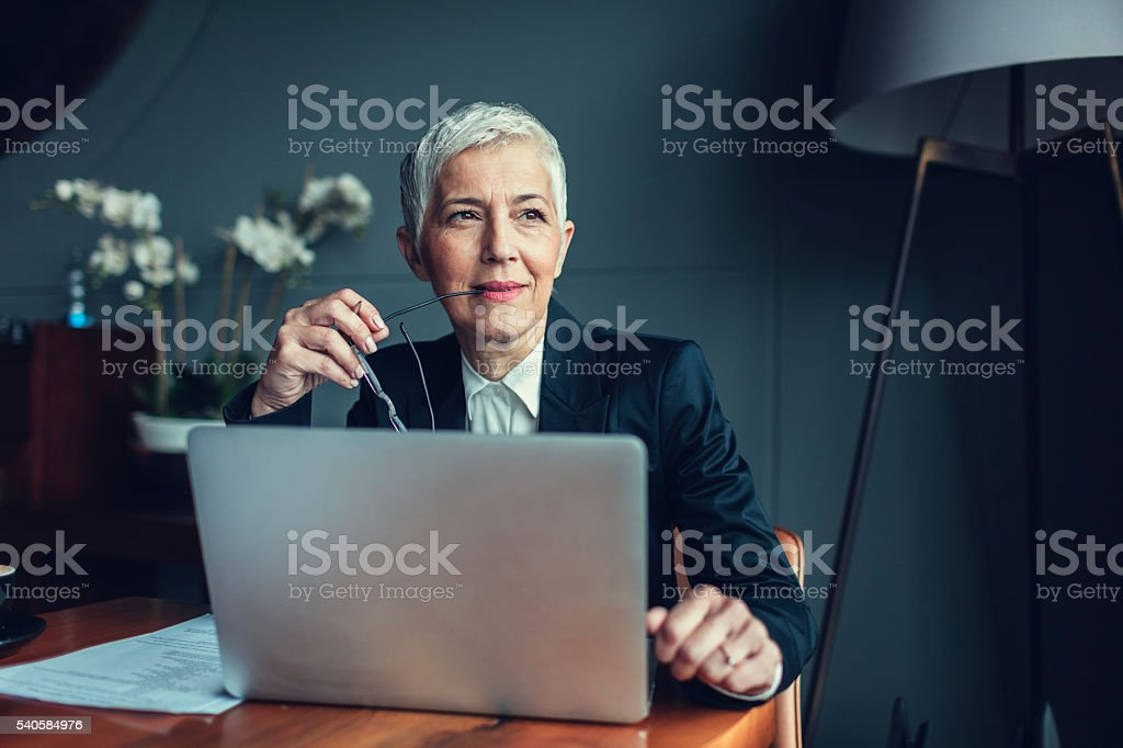 Mature Businesswoman In Her Office. stock photo