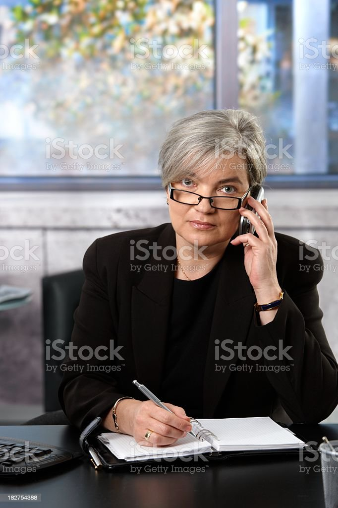 Mature businesswoman on the phone royalty-free stock photo