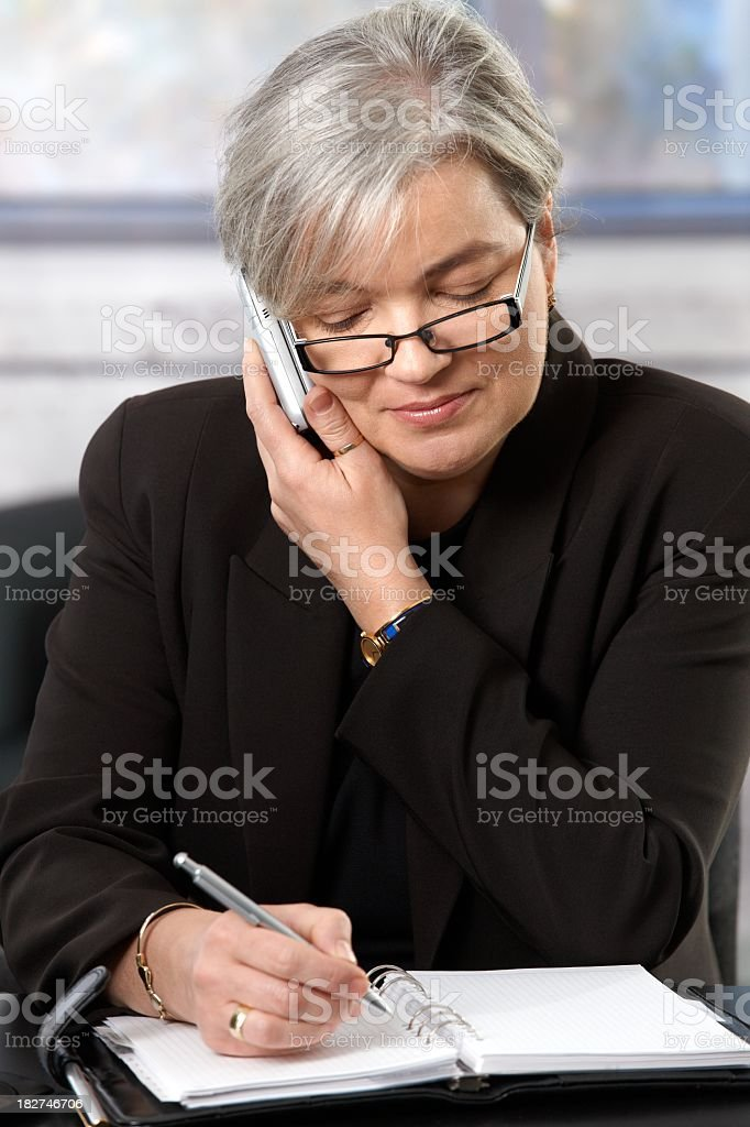 Mature businesswoman planning schedule royalty-free stock photo