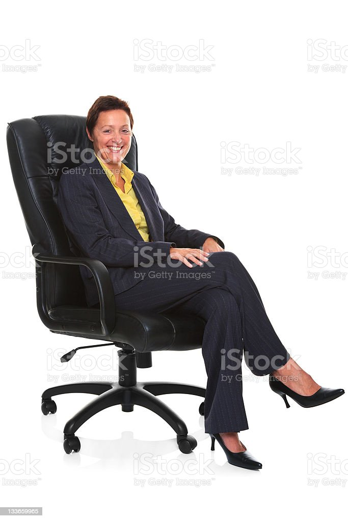 mature sat in leather chair isolated stock photo