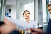Mature businesswoman sitting attentively during meeting