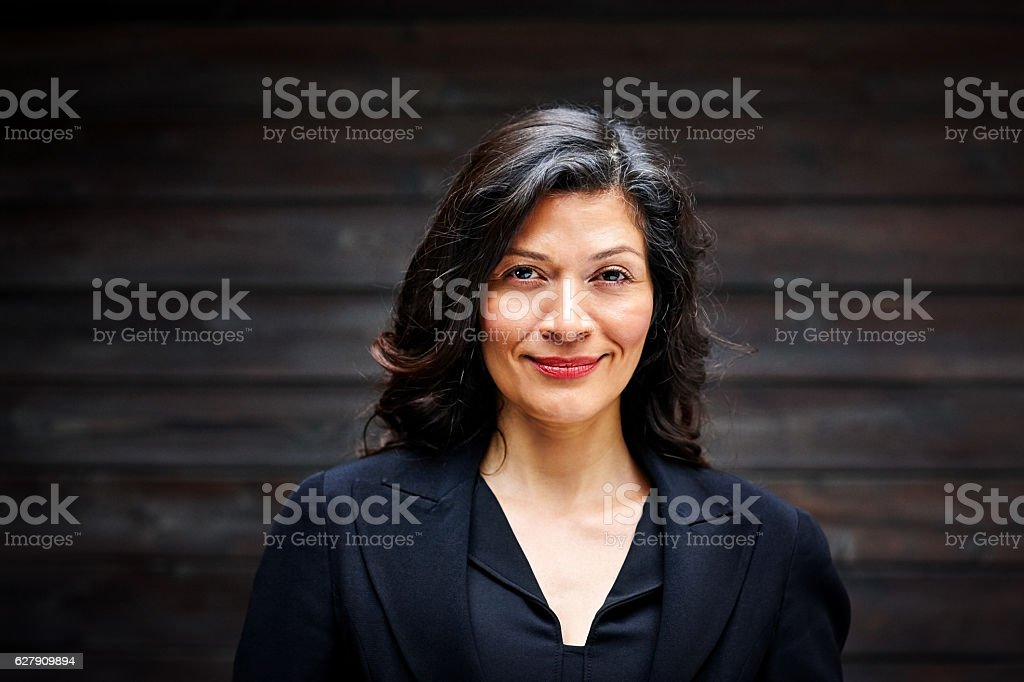 Mature businesswoman smiling confidently stock photo