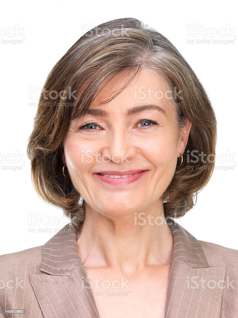 Mature businesswoman smiling stock photo
