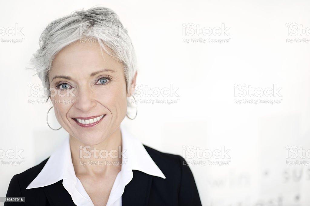 Mature businesswoman smiling stock photo