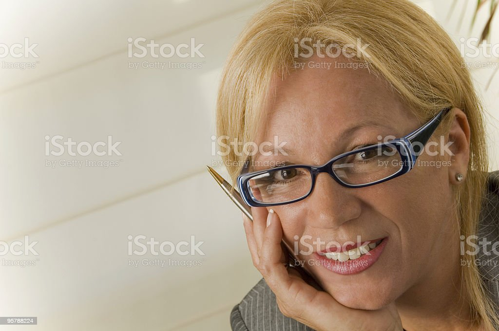 Mature businesswoman smiling royalty-free stock photo