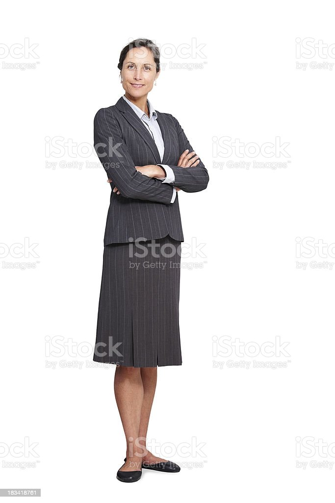 Mature businesswoman standing with her arms folded royalty-free stock photo